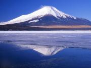 Mount Fuji reflecting from a lake