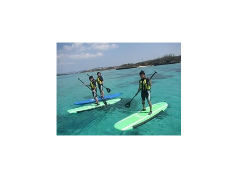SUP boarding on the clear blue waters of Okinawa