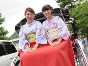 Kimono wearing Japanese women on a rickshaw