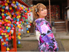 Wearing a bright kimono at a Kyoto temple