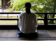 Sitting Zazen overlooking a temple garden