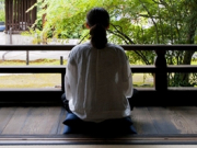 Sitting Zazen overlooking a temple garden