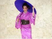 A kimono wearing Okinawan dancer performs