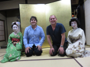 Tourists taking a picture with maiko in kyoto