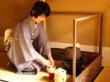 A tea instructor whisking matcha green tea