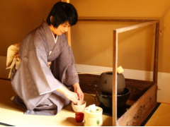 A tea instructor whisking matcha green tea