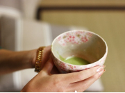 Matcha tea in a cherry blossom patterned cup