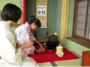 Preparing matcha green tea in a yukata