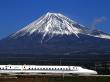 Fast Shinkansen in front of Mount Fuji