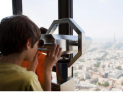 Child-looking-through-telescope-at-Eiffel-Tower
