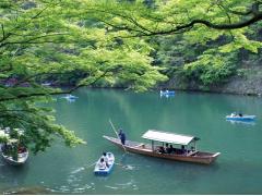 Leisurely cruising downstream on a yakatabune