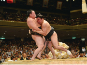Sumo wrestlers fighting at the tournament