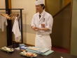Sushi chef demonstrating how to make sushi