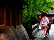 A kimono wearing woman walking in Gion