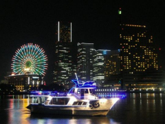 Bright lights of Yokohama during a night cruise