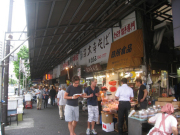 Visitors stopping at a Tsukiji fruit stall
