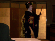 Graceful maiko performing traditional dance