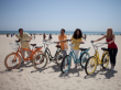 Pedego-couples-on-beach-72dpi-300x199