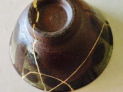 A bowl repaired by kintsugi, using gold powder