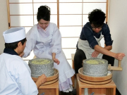 Grinding soba into flour in a classic mortar