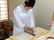 Cutting fresh soba dough into noodles