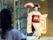 A maiko performing classic dance in Kyoto