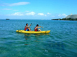 Two people paddling a sea kayak in Okinawa