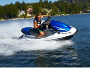 Blasting over the water on a jet ski