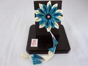 Vibrant blue and white chirimen corsage