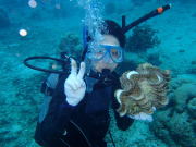 Diver posing with a giant clam