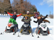 Riding snowmobiles over fresh snow in Japan