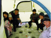 Family ice fishing on the Barato River