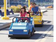 Driving School_Girl in Blue Car_CMYK_HR