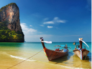 Traditional long-tail boats docked at Railay Beach
