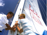 Island Discovery Hoisting Sail
