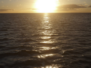Sunset-and-fireworks-sun-over-ocean