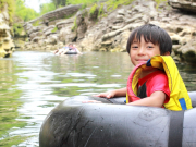 Boy Tubing Down River