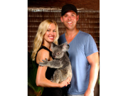 couple posing with koala