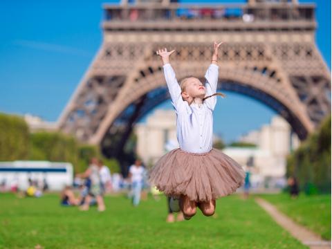 France_Paris_Eiffel_Tower_Girl_Jumping_shutterstock_343330691