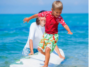 US_Hawaii_Child_Surfing_shutterstock_273341357