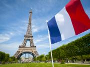 France_Paris_Eiffel_Tower_Flag_shutterstock_632323880