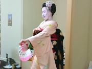 a maiko performing an elegant dance