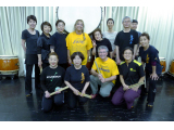 My wife and in gold shirts at drumming class