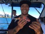 スタッフのお兄さんとわたしの釣った魚!