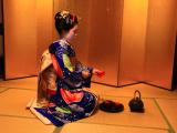 Maiko performs the tea ceremony.